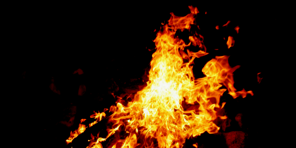 A fire is shown against a black background.