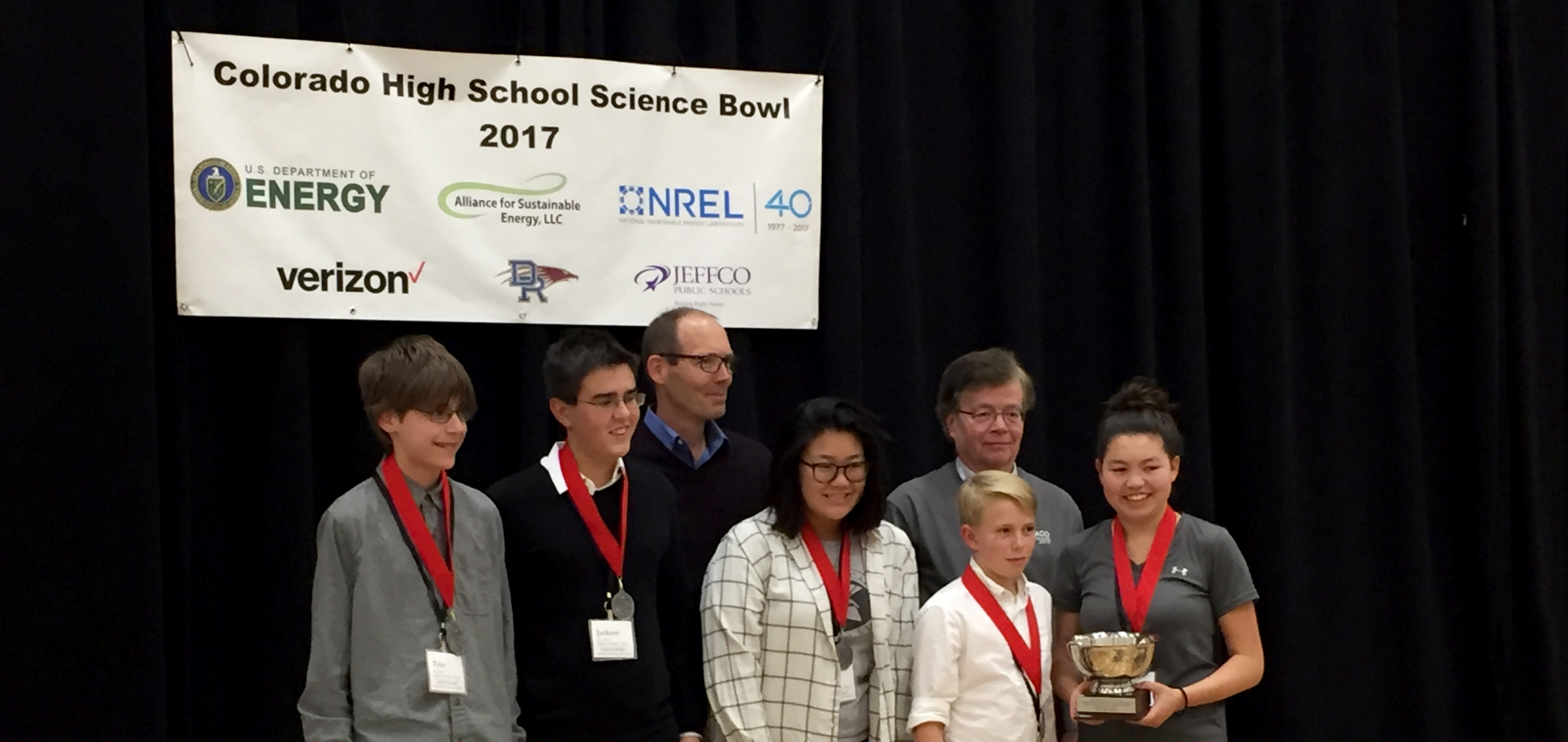 The High School Science Bowl team poses with their trophy.