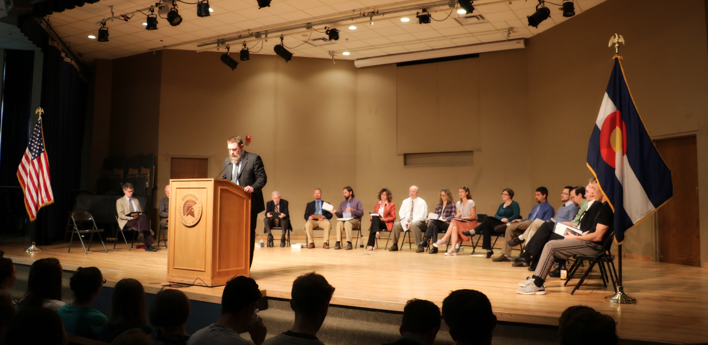 Mr. Anderson speaks at an awards ceremony.